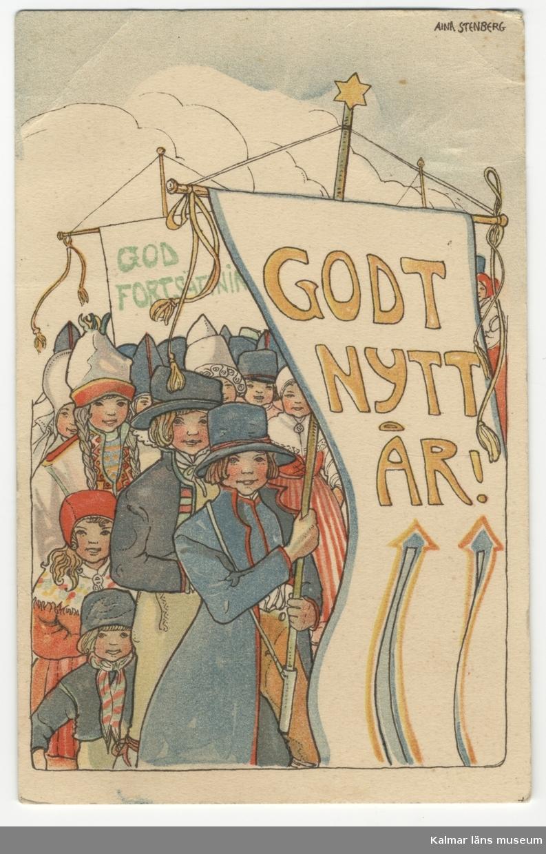 Folkdräktsklädda barn bildar tåg med stora fanor/standardts med texten Godt nytt år och God fortsättning.