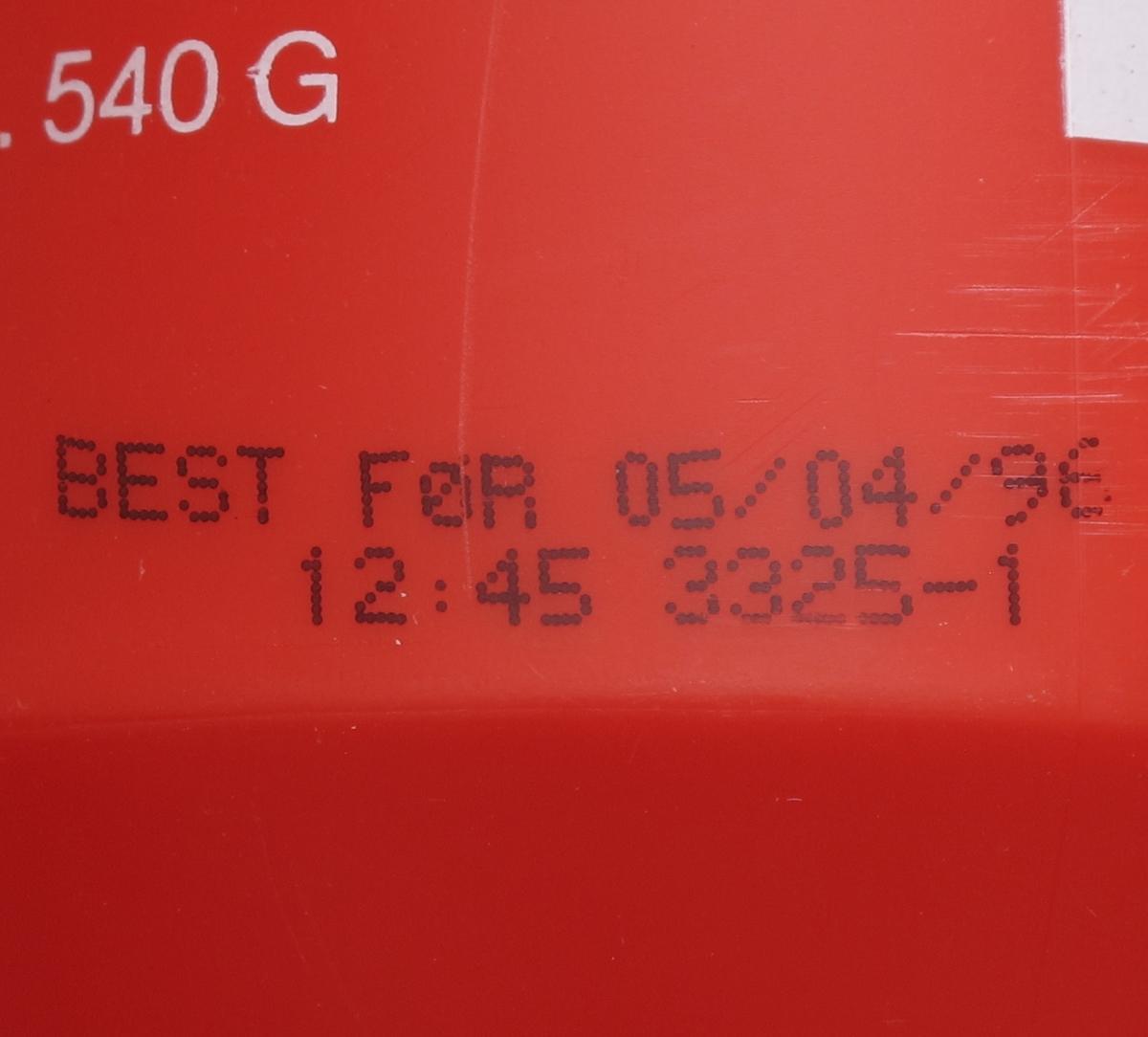 Spruteflaske av plast, med  540 g. Påtrykt tekst  med opplysninger om  innhold og oppbevaring, varemerke og strekkode.