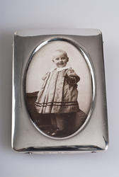 "This first item is a framed photograph of Kirsten Flagstad as a young girl. Even as a 1-year-old, the musicality had begun to show and she called herself ""Titten Tangerin"", or Kirsten Singer. Maja Flagstad and Michael Flagstad, her parents, were renowned musicians in Kristiania. This pictures is taken in 1896 and is a part of a series of family photos."