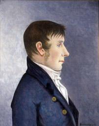 Portrett av Jørgen Aall.  Mann i profil, mørkt, kort hår, kinnskjegg  Mørk blå kledning med to knapper, hvit skjorte