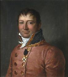 Portrett av sorenskriver Wilhelm F.K. Christie. Rød sorenskriveruniform, høy krave med gull, hvitt kalvekryss. 1 ordensstjerne. (Foto/Photo)
