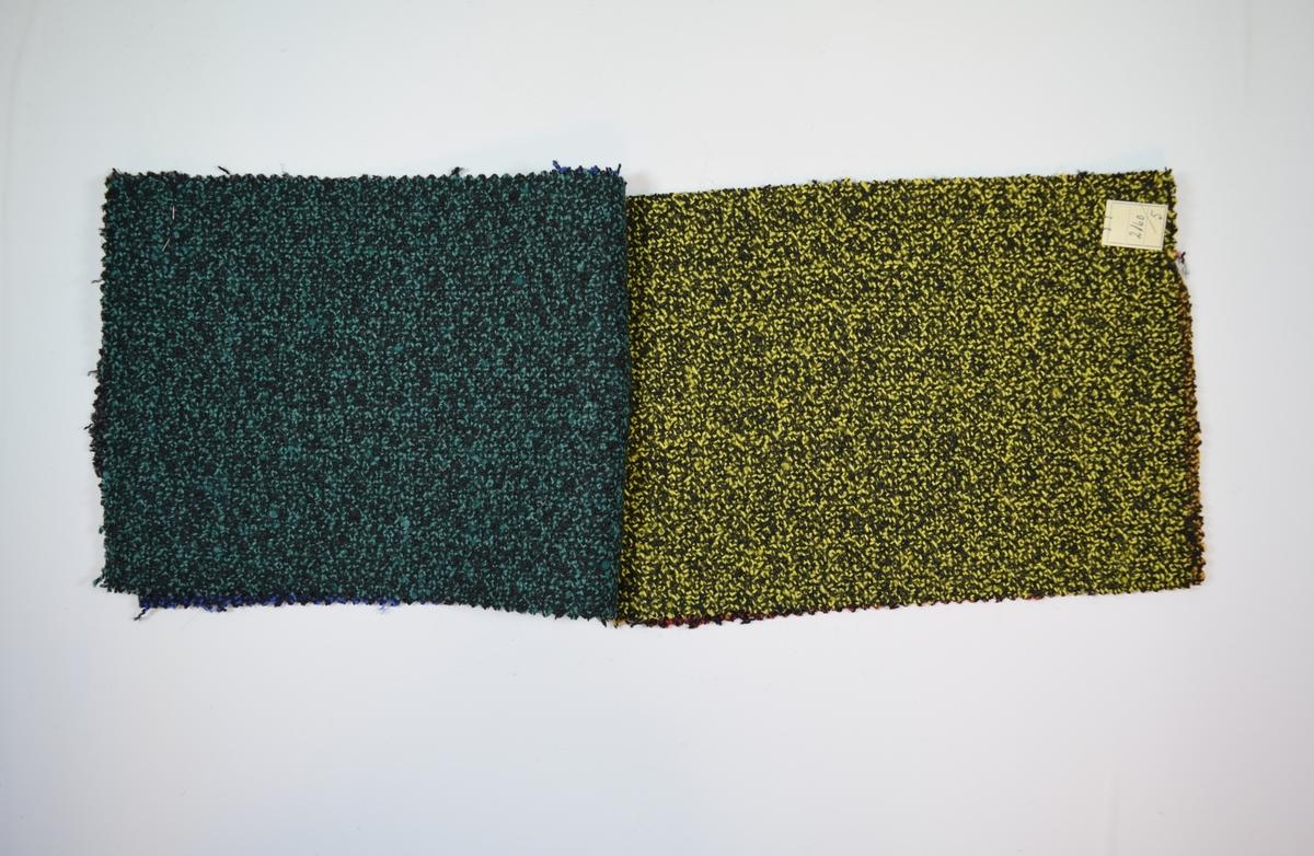 Syv rektangulære stoffprøver klippet med sikksakk-saks, stiftet sammen på midten av den ene kortsiden. Middels tykke tofargede stoff, alle i kombinasjon med svart. Stoffene er merket med en firkantet papirlapp, festet til stoffet med metallstifter, hvor stoffnummer er fylt ut for hånd.   Stoff nummer.: 2160/1, 2160/2, 2160/3, 2160/4, 2160/5, 2160/6, 2160/7.