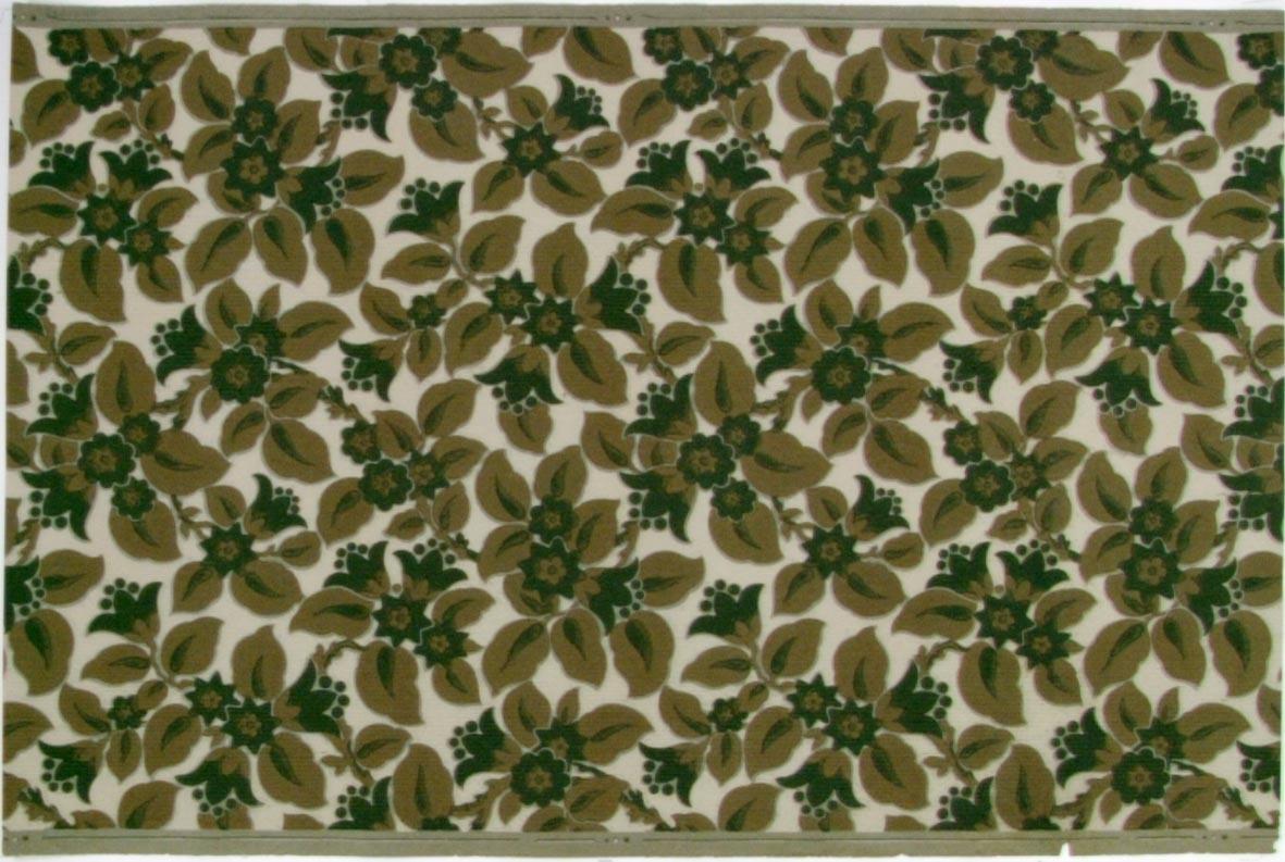 Tätt ytfyllande mönster med stiliserade blommor och blad. Tryck i beige och grönt på en cremefärgad bakgrund. Ljusgrått genomfärgat papper.