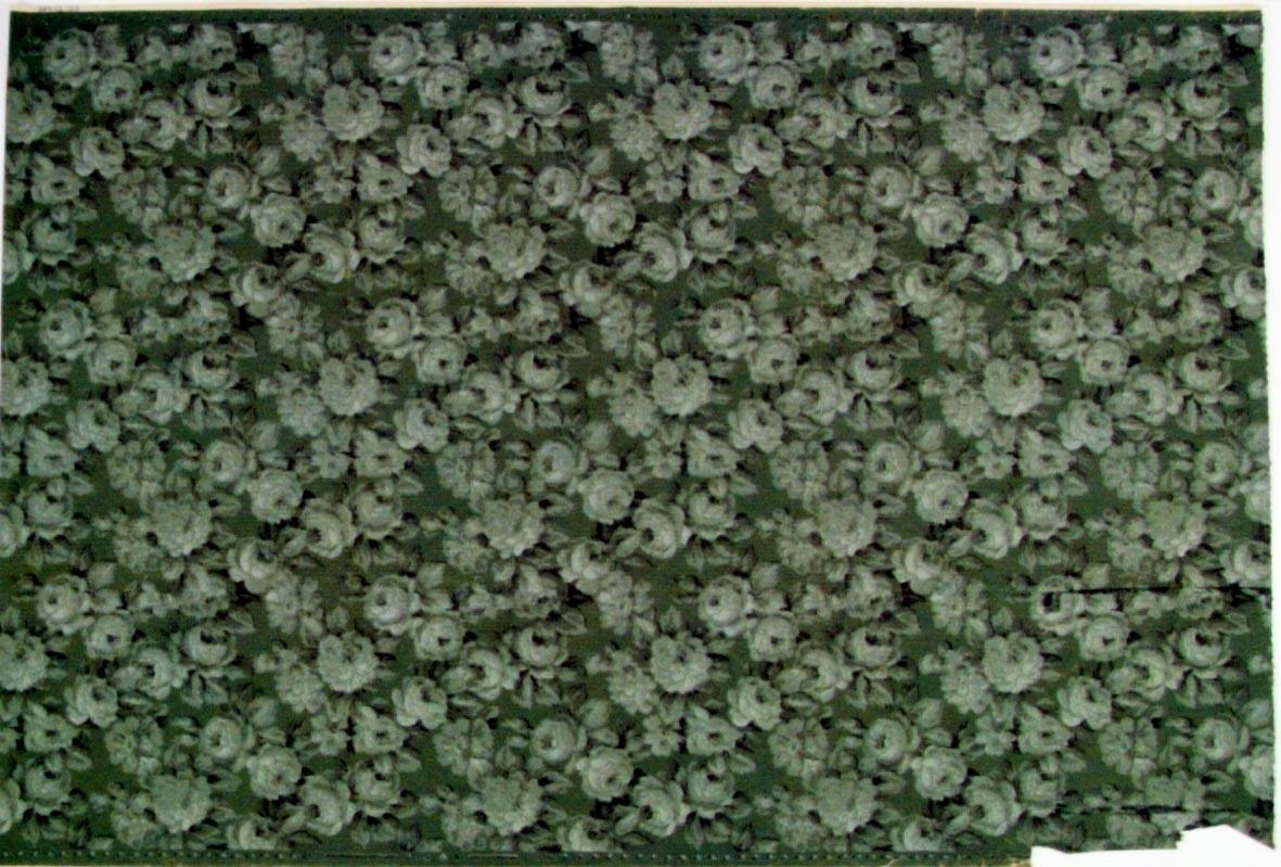 Tätt ytfyllande rosenmönster i flera grå och grågröna nyanser på en grön bakgrund.