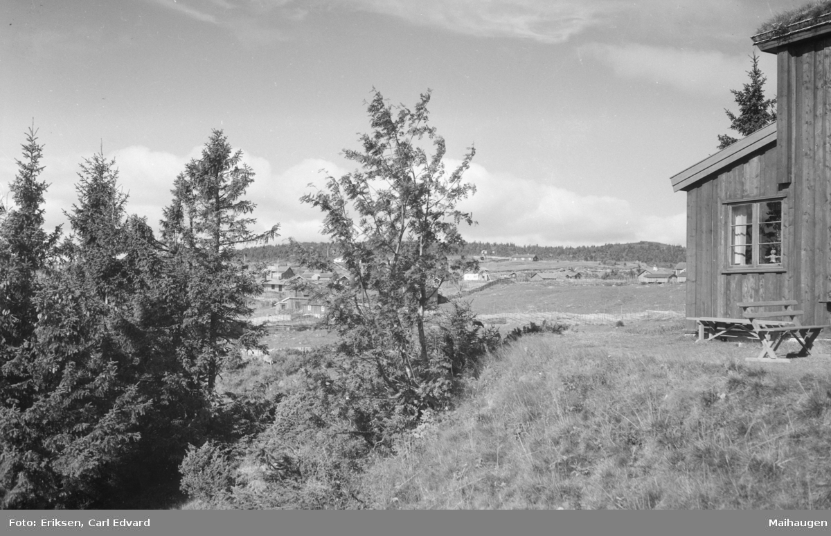 Landskap med hytter på Sjusjøen.