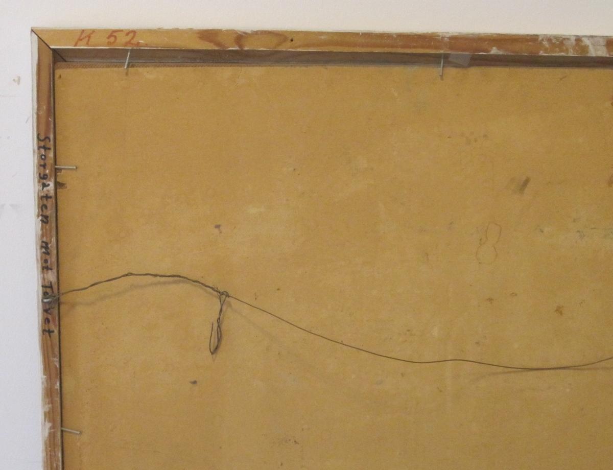 På baksiden av rammen er en innskrift: Storgaten mot Torvet.