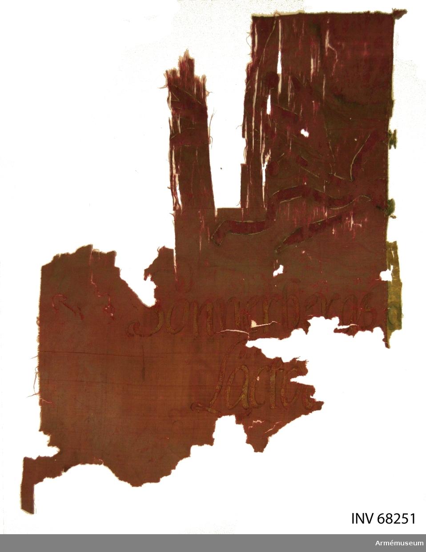 Fragment av en uppbådsfana tillhörande Rackeby och Sunnersbergs gäll (pastorat), Kållands härad i Läckö grevskap.