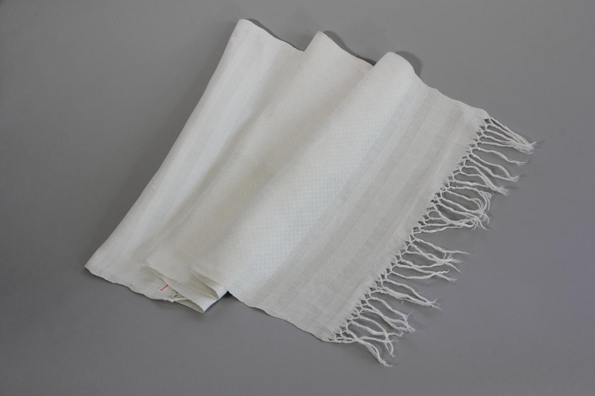 Paradhandduk, duk, av mönstervävd vit bomullsväv med frans.