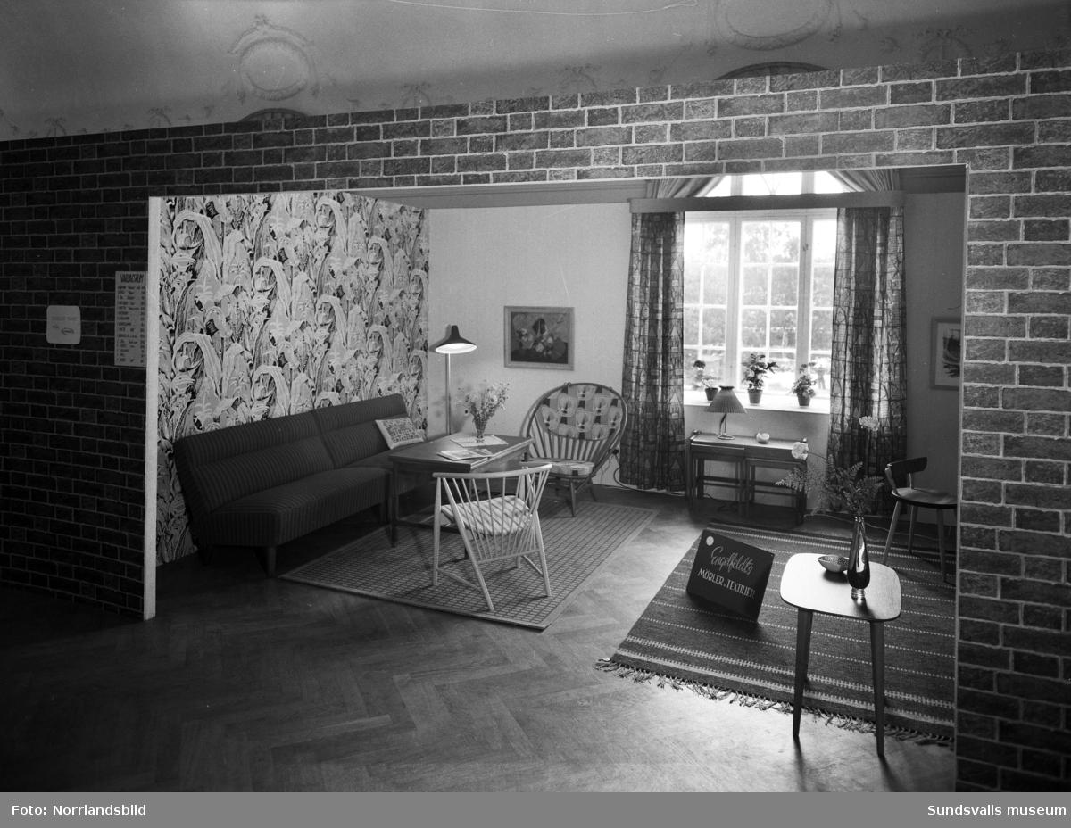 Utställning på W6 med temat Morgondagens hem. Miljöer med möbler och inredning från lokala butiker och firmor.