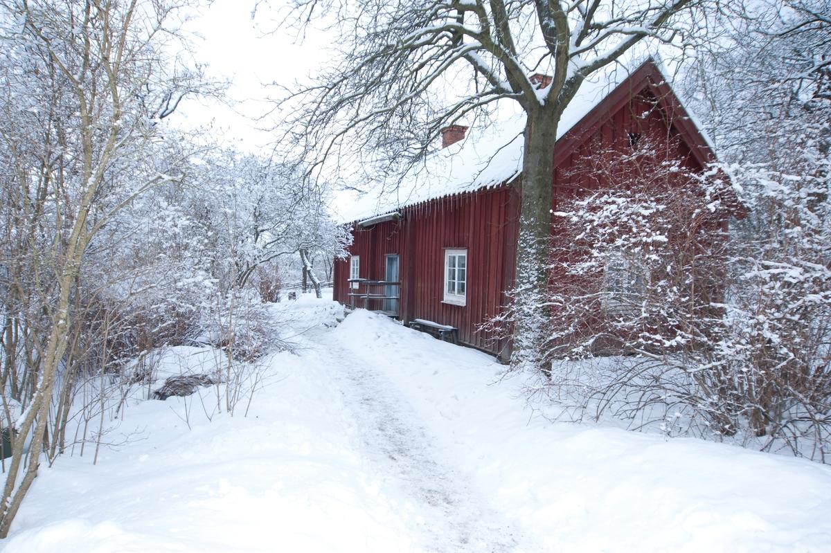 Statarlängan på Skansen i vinterskrud