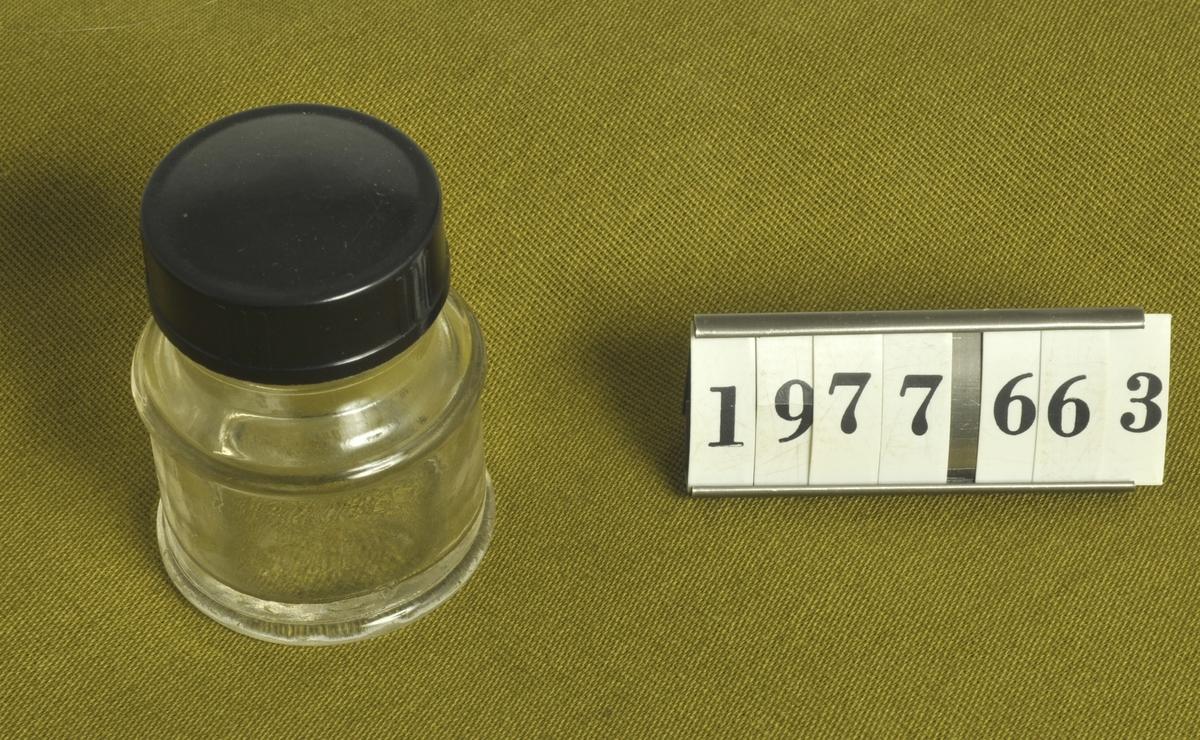 Rund form. Skruvlock av bakelit.  Höjd med lock: 5,8 cm.