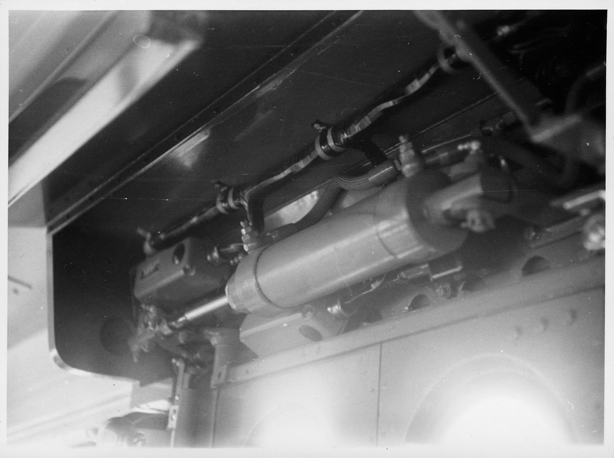 Motor till dörröppning i en buss.