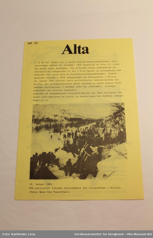 """Løpeseddelen heter """"Alta"""" og har norsk tekst. Jfr. AM 00146, AM 00147, AM 00148 Produsent: Folkeaksjonen mot utbygging av Alta/Kautokeinovassdraget."""