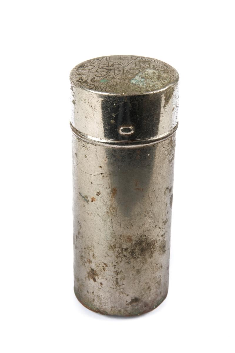 Sylinderformet boks til barbersåpe.
