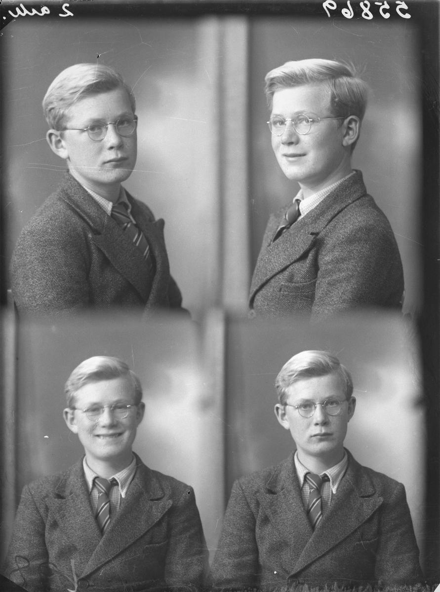 Portrett.  Ung lyshåret gutt/mann med briller i mørk dress, lys skjorte og flerfarget/stripet slips. Bestilt av Magne Urdahl. Øvre Vats.