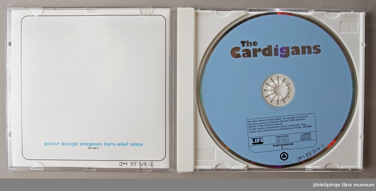 CD-skiva, musik med gruppen The Cardigans. Skiva i tredelat, hårt plastfodral med booklet (häfte) i framsidan och inlaga (pappersark) i baksidan.   Innehåll: 1. Carnival 2. Gordon's Gardenparty 3. Daddy's Car 4. Sick And Tired 5. Tomorrow 6. Rise And Shine 7. Beautiful One 8. Travelling With Charley 9. Fine 10. Celia Inside 11. Hey! Get Out of My Way 12. After All... 13. Sabbath Bloddy Sabbath  JM 55314:1, Skiva JM 55314:2, Booklet JM 55314:3, Fodral