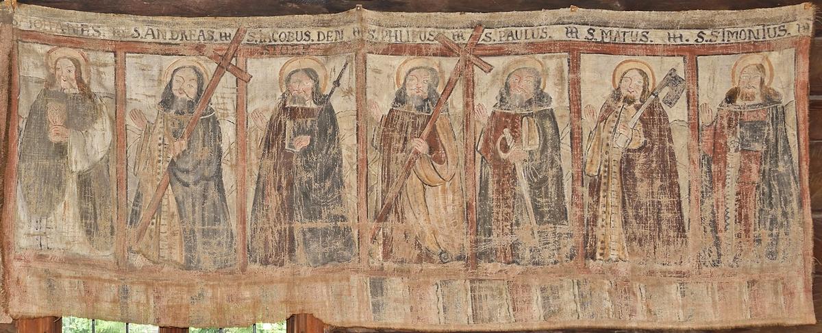 Bonad, målad i dova färger på linneväv. Föreställer de sju apostlarna med attribut. Figurerna placerade i avgränsade fält. Ovanför fälten apostelns namn. Kopia av bonad i Nordiska museet, NM.0099767.