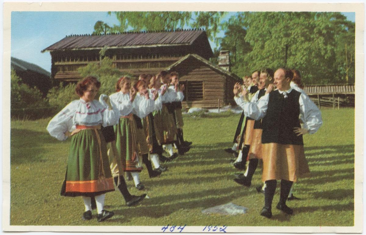"""Vykort med motiv från Skansen. """"Folkdans från Orsa, Dalarna."""""""