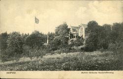 Vykort med motiv över herrgården vid Hovid på Alnö.