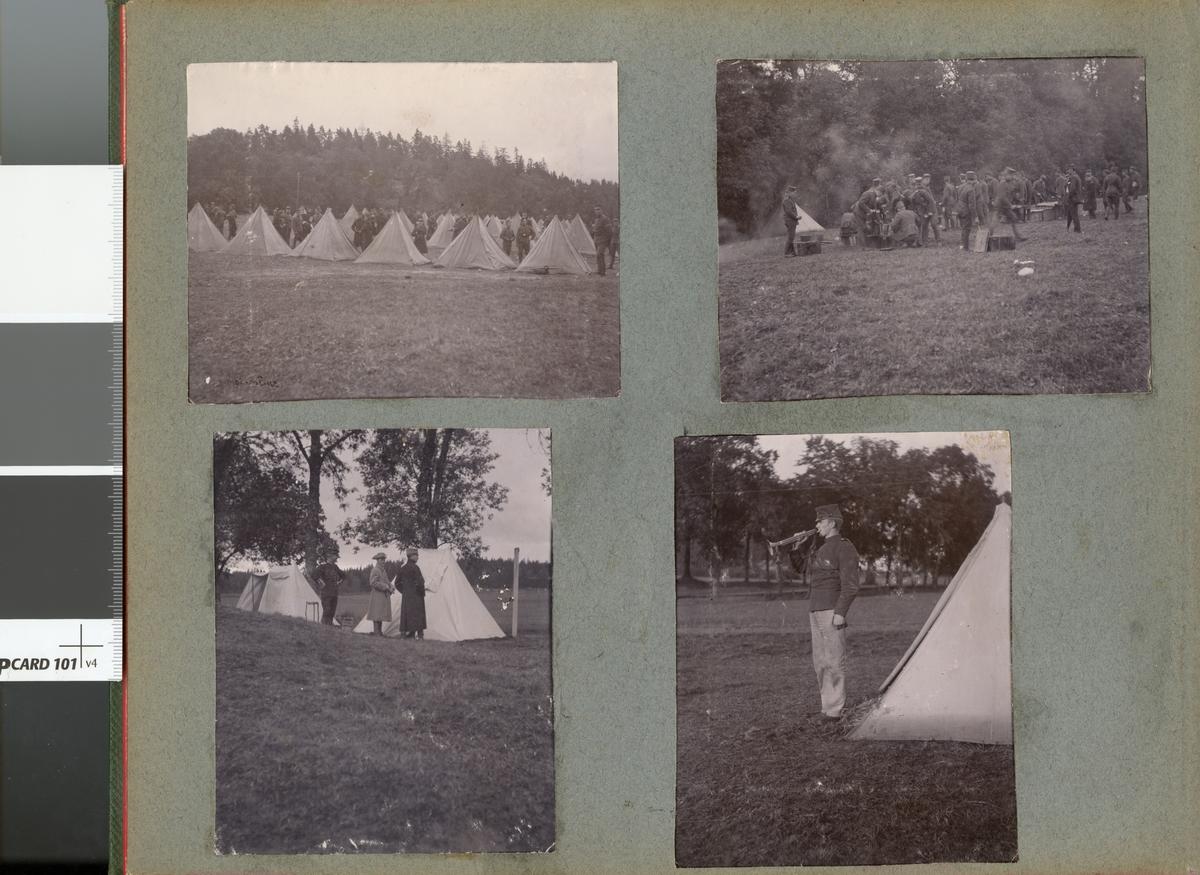 Soldat från Fortifikationen blåser trumpet utanför tält.