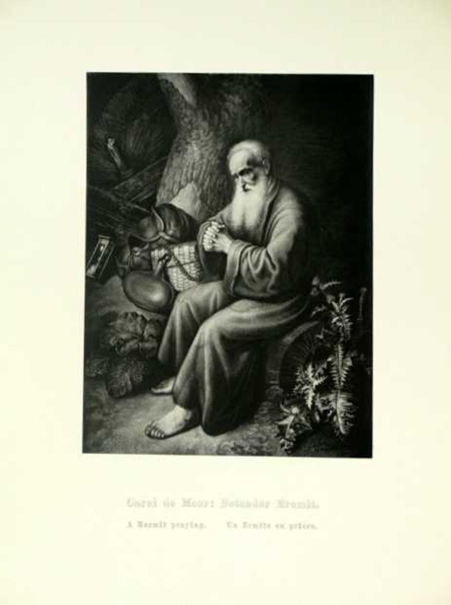En gammel mann sitter med foldede hender.