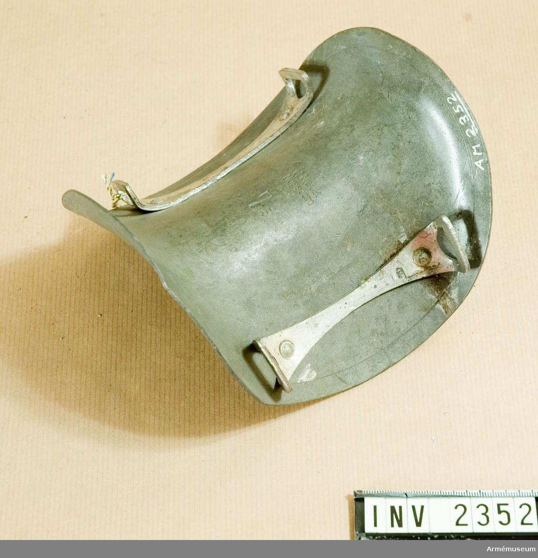 Mankkamskyddare. Stl nr 7,5. Modell från konstruktionskontorets modellkammare, märkt nr:I-433. 6/12 1946.