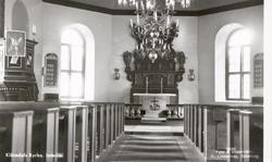 """Tryckt text på kortet: """"Klövedals kyrka. Interiör""""."""