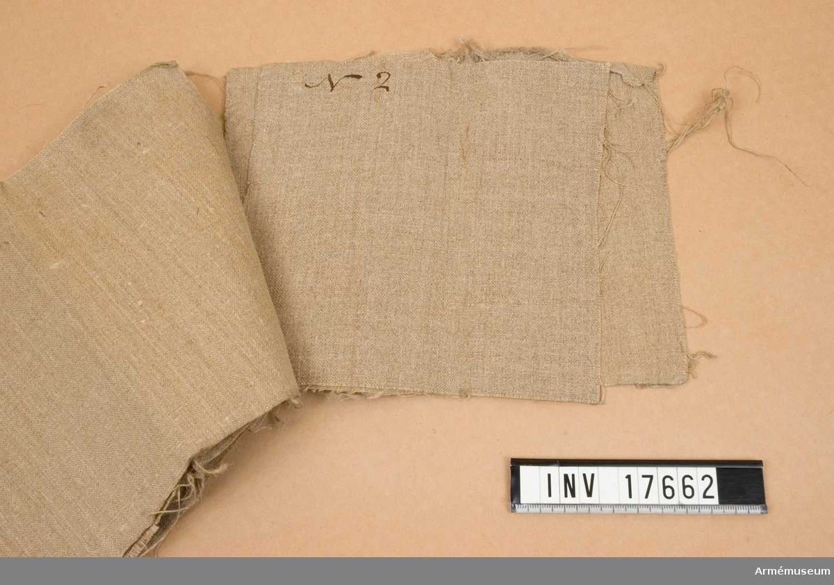 Grupp C I. Prover av väv till skyddstält, Frankrike. Medfört till Sverige 1864 av greve Cronhielm.