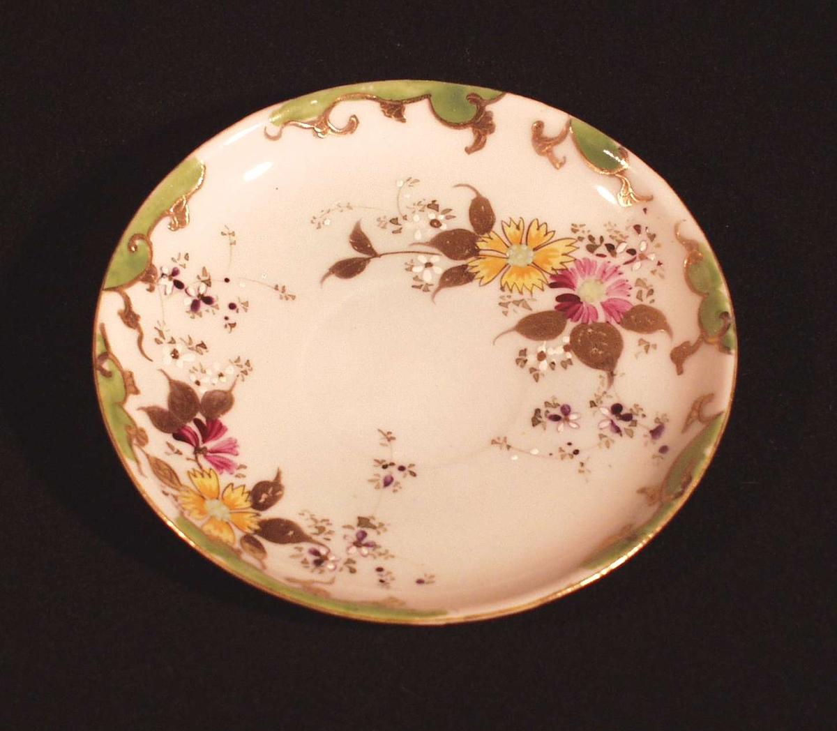 Rund skål med opphøyet dekor (blomstermotiv).