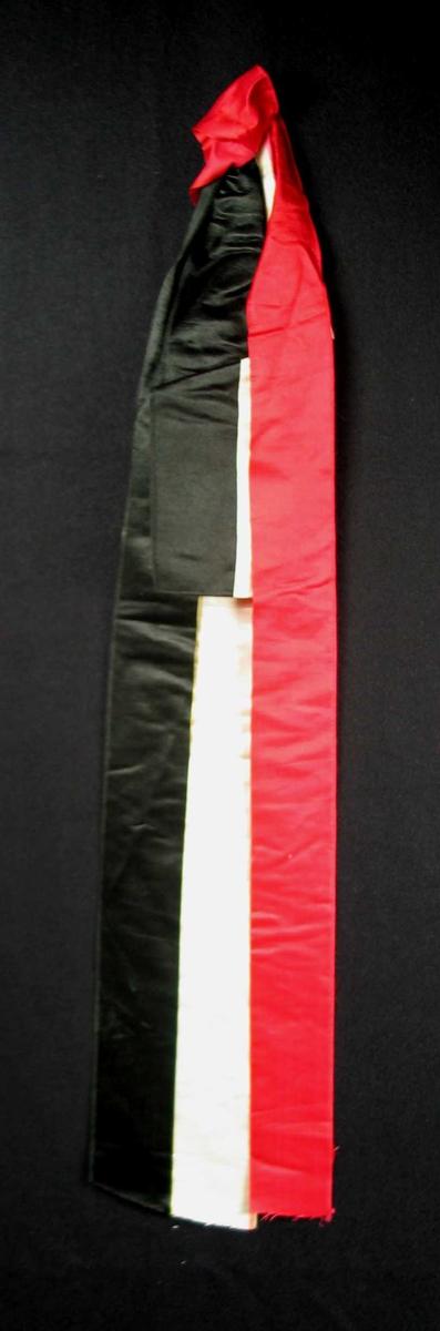 Begravelsessløyfe i hvit, rød og svart silke. Uten tekst.