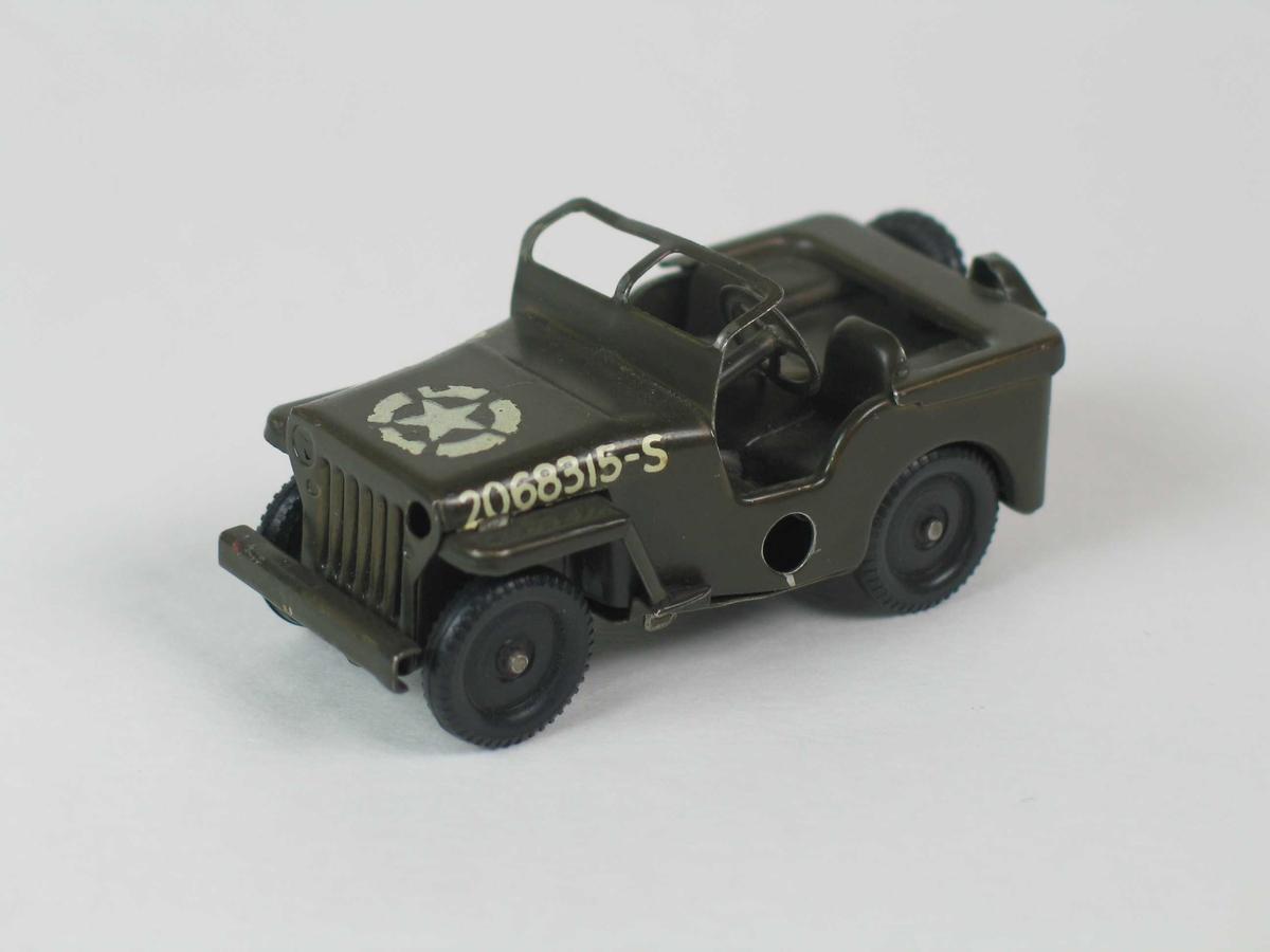 Lekebil i metall. Militærgrønn jeep med nummer og stjerne på panseret.