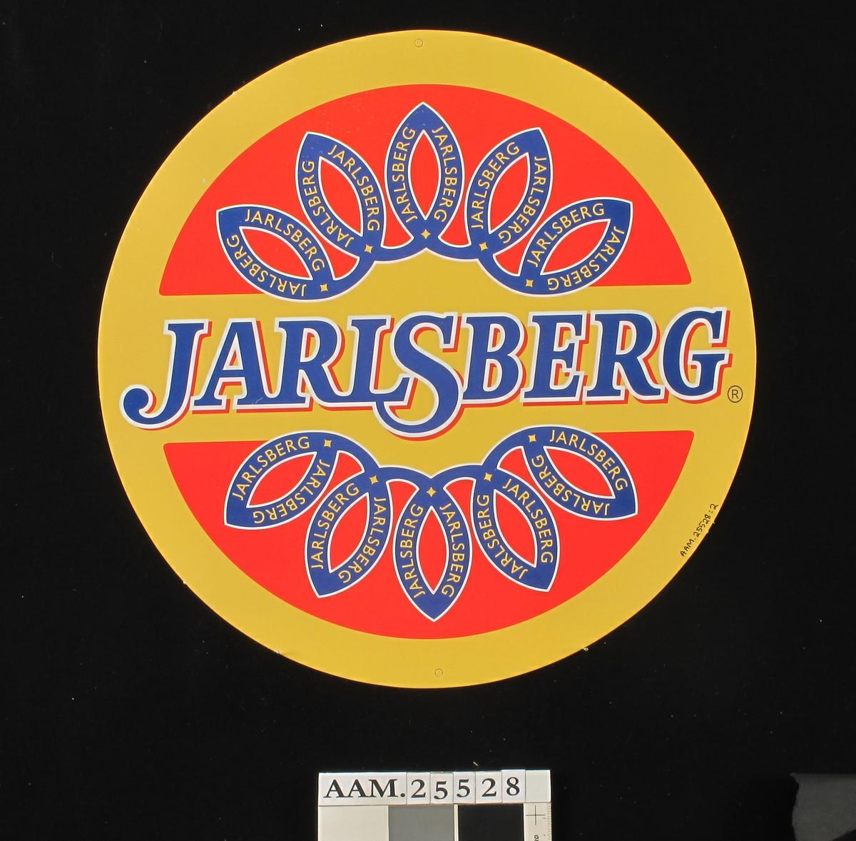 Rund Jarsberg-ost / fargefoto av ostestykke og ostekniv.